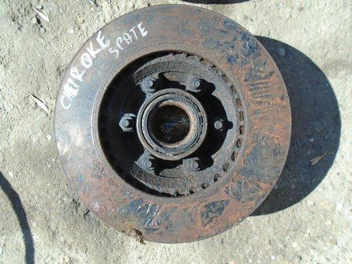 Butuc + disc spate grand cherokee