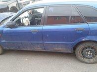 Dezmembrez Mazda 323F 1324 cmc, 53 kw, albastru benzina