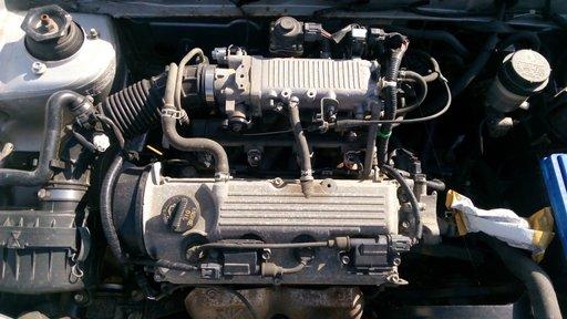 Dezmembrez Suzuki Swift 2003 motor 1298 cc benzina 62 kw, tip motor G13BB, cutie de viteze manuala