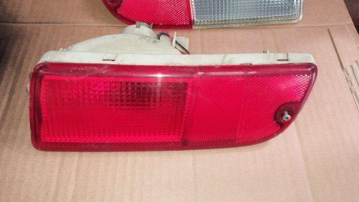 Lampa / stop stanga spate Suzuki Ignis, an 2005, in bara